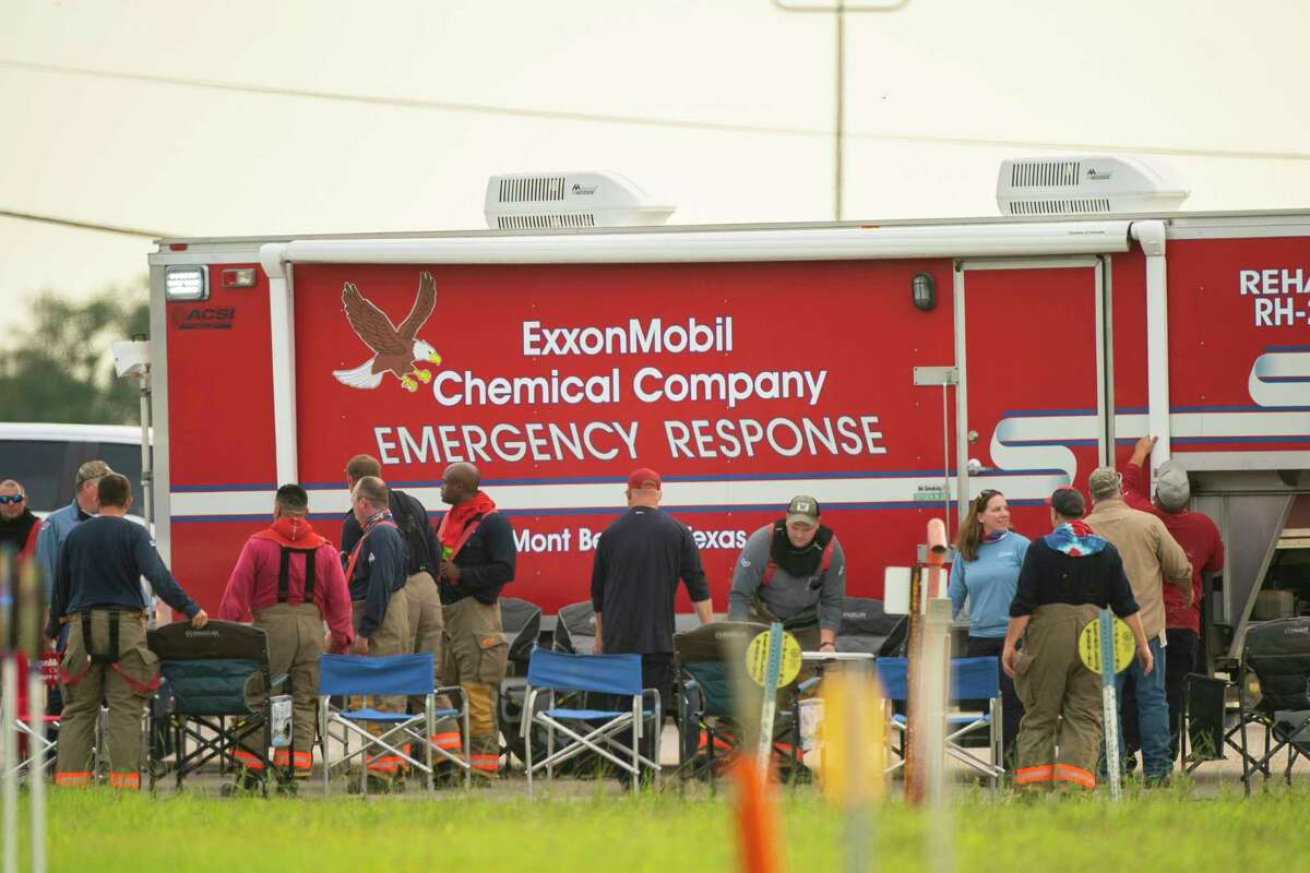 An ExxonMobil emergency response team sets up chairs at a fire at a natural gas facility, Wednesday, July 29, 2020, at the Lone Star NGL in Mont Belvieu. A natural gas storage facility exploded Wednesday in Mont Belvieu after a contractor struck an underground pipeline, officials say. No injuries have been reported. All facility workers are accounted for, said Mont Belvieu city spokesman Brian Ligon.