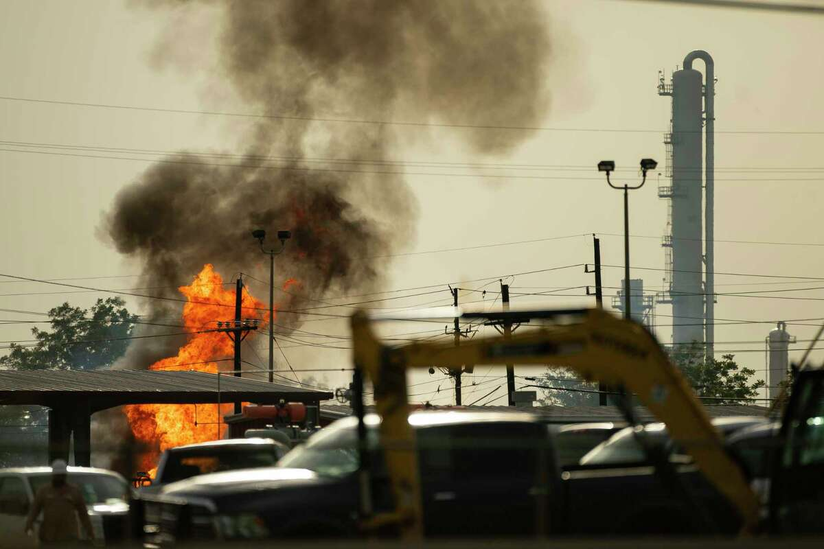 A fire burns at a natural gas facility, Wednesday, July 29, 2020, at the Lone Star NGL in Mont Belvieu. A natural gas storage facility exploded Wednesday in Mont Belvieu after a contractor struck an underground pipeline, officials say. No injuries have been reported. All facility workers are accounted for, said Mont Belvieu city spokesman Brian Ligon.