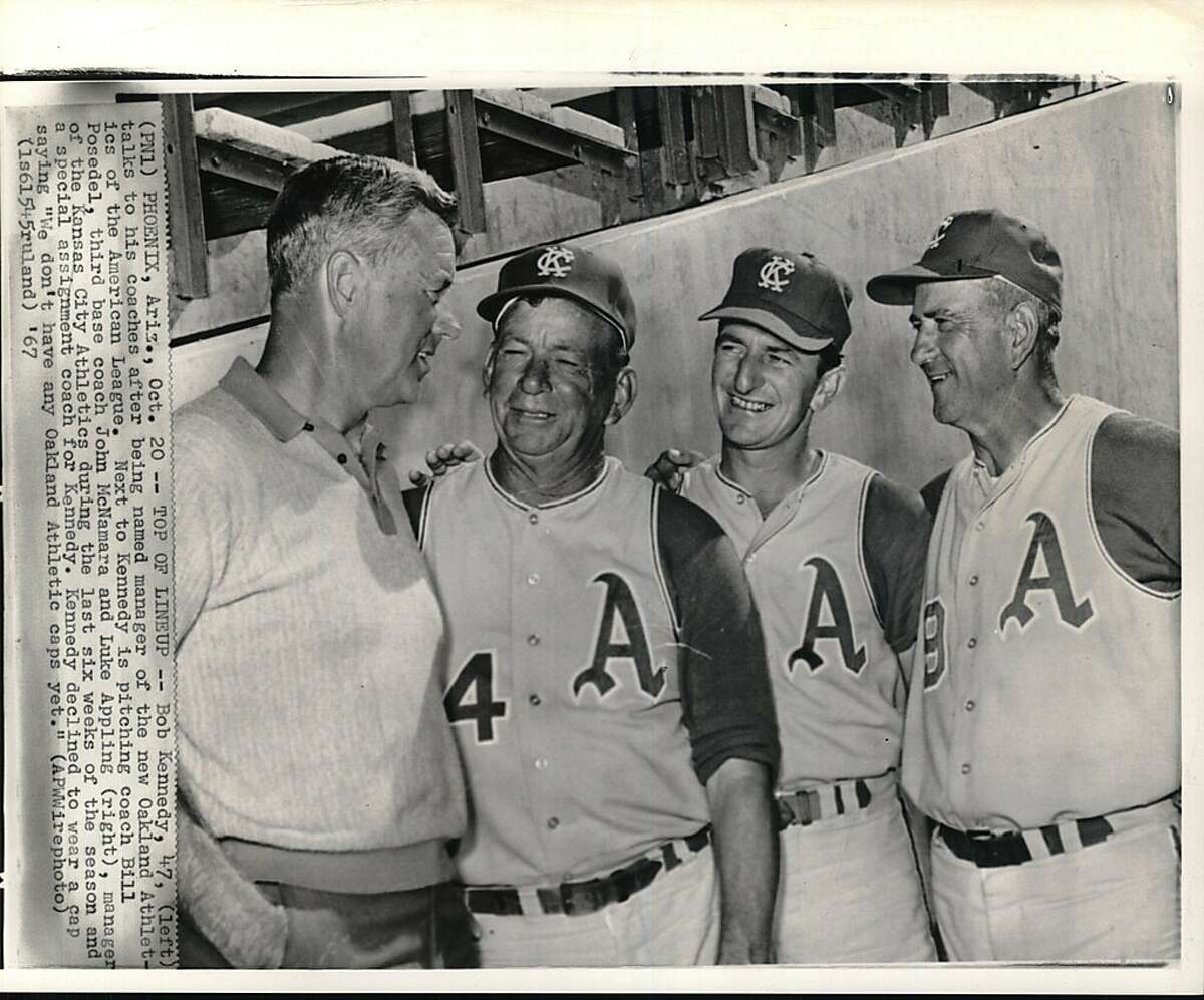 """Kennedy, Bob (Oakland Athletics manager). Phoenix, Arizona. Bob Kennedy, 47, (left) talks to his coaches after being named manager of the new Oakland Athletics of the American League. Next to Kennedy is pitching coach Bill Posedel, third base coach John McNamara and Luke Appling (right), manager of the Kansas City Athletics during the last six weeks of the season and a special assignment coach for Kennedy. Kennedy declined to wear a cap saying """"We don't have any Oakland Athletic caps yet."""""""