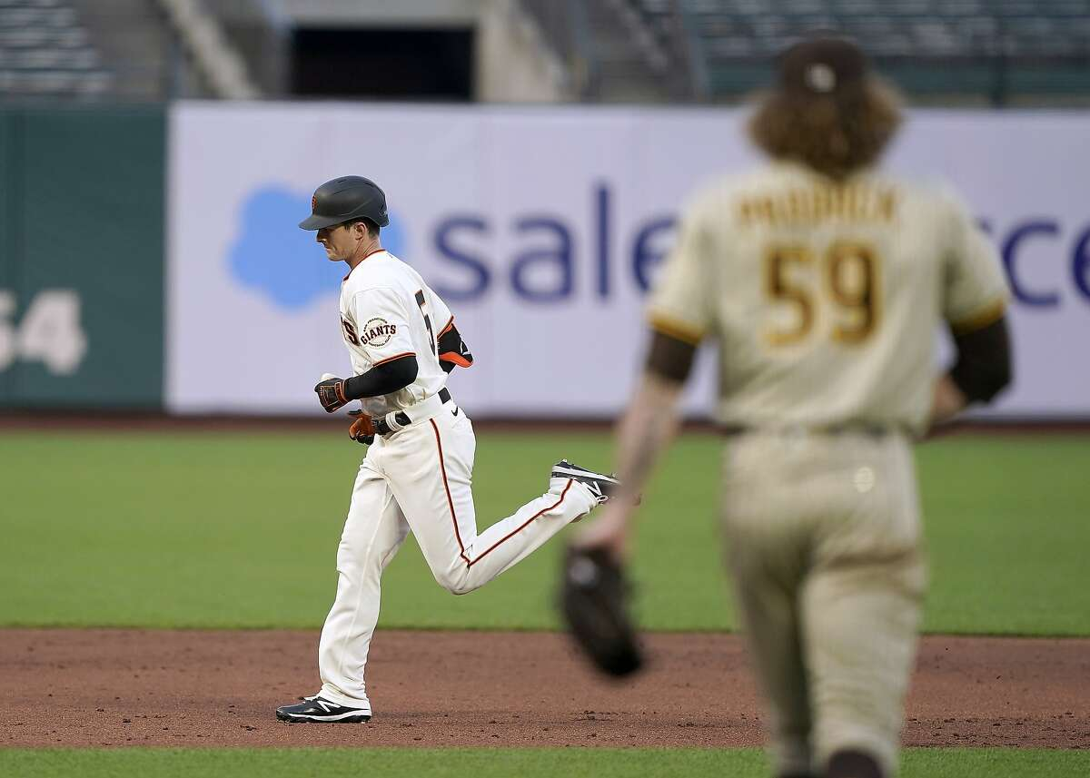 San Francisco Giants' Mike Yastrzemski, left, runs the base after hitting a solo home off San Diego Padres pitcher Chris Paddack (59) during the third inning of a baseball game in San Francisco, Wednesday, July 29, 2020. (AP Photo/Tony Avelar)