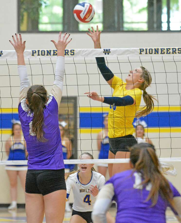 Amber Daniel (right) and the Wayland Baptist volleyball team may see their season schedule altered after the NAIA Council of Presidents voted to move most fall sports national championships to the spring of 2021. WBU volleyball was slated to begin the season on Sept. 6 Photo: Nathan Giese/Planview Herald
