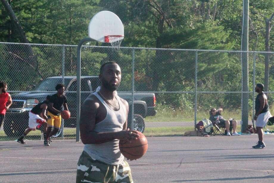 Former Baldwin standout Daekwon Fisher shoots baskets at Hollister Park on Saturday. (Star photo/John Raffel)