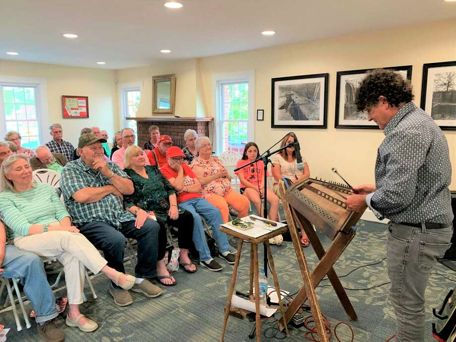 Chris Vallillo entertains the crowd at the Lake County Historical Society 2019 Folk Fridays concert series playing the hammer dulcimer. Vallillo plays multiple stringed instruments including slide guitar, dulcimer and jaw harp. He will perform at 7 p.m., July 31, at the open barn doors of the Historical Society Museum in Baldwin as part of the 2020 Folk Fridays concert series. (Submitted photo)