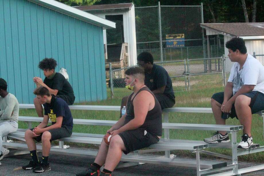 Baldwin senior lineman Ian Lemieux (middle) listens to coaches' instructions after a conditioning session last week. (Star photo/John Raffel)
