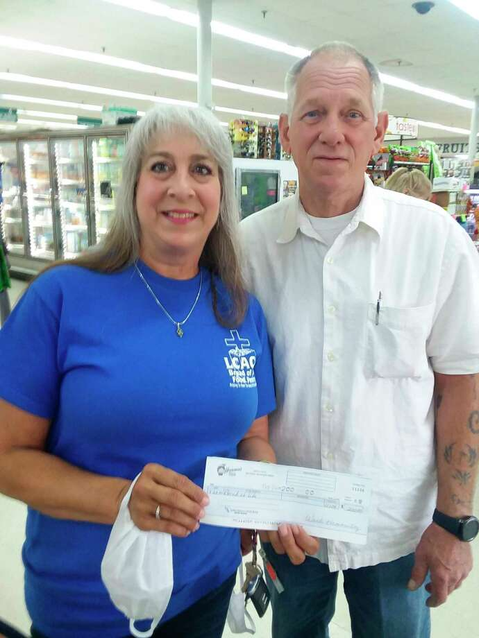 """The Houseman's Foods """"dollars at checkout"""" campaign collected another $200 over the July 4 weekend, to donate to the Bread Of Life Pantry.Kelly Morton, Manager at Houseman's, presented Bread of Life Pantry director Lynne Mills with the check for $200. (Submitted photo)"""