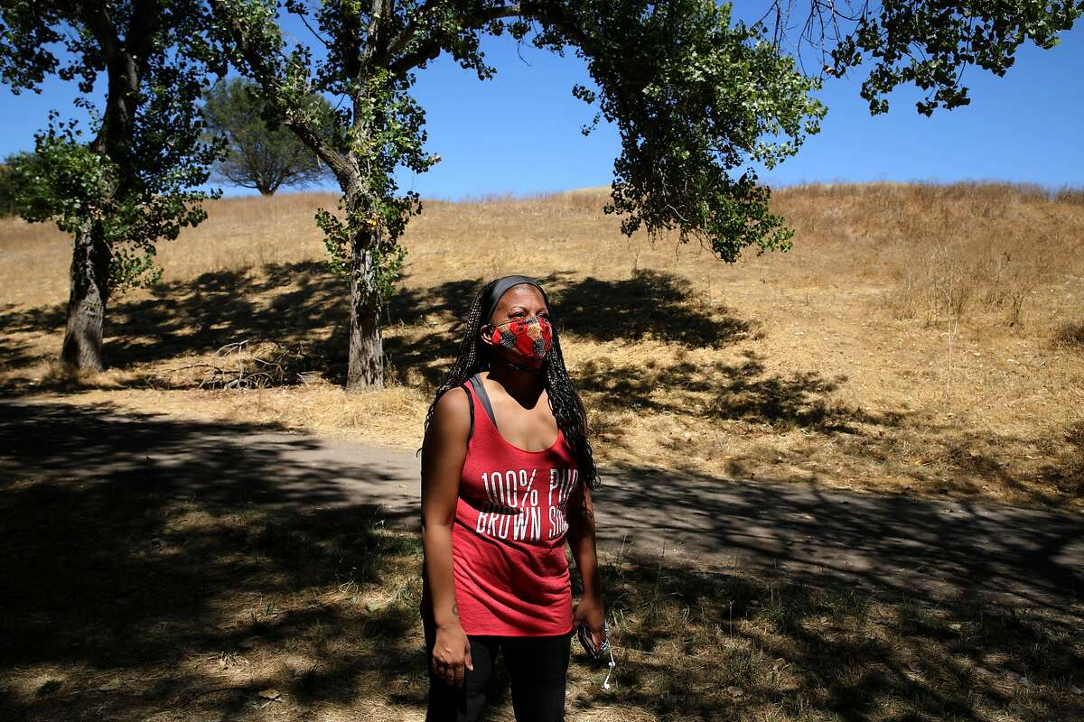 Tiffany Black, 40, poses for a portrait at Garin Regional Park on Wednesday, July 29, 2020, in Hayward, Calif. With coronavirus cases surging and the future of unemployment benefits still up for debate in Congress, over a million Americans are still expected to file for unemployment this week. Tiffany was just laid off from Airbnb, but is using the time to refocus and reconsider what she wants to be spending her time on. She's been reading a lot, connecting with others who've been laid off from Airbnb, writing and applying to grad school.