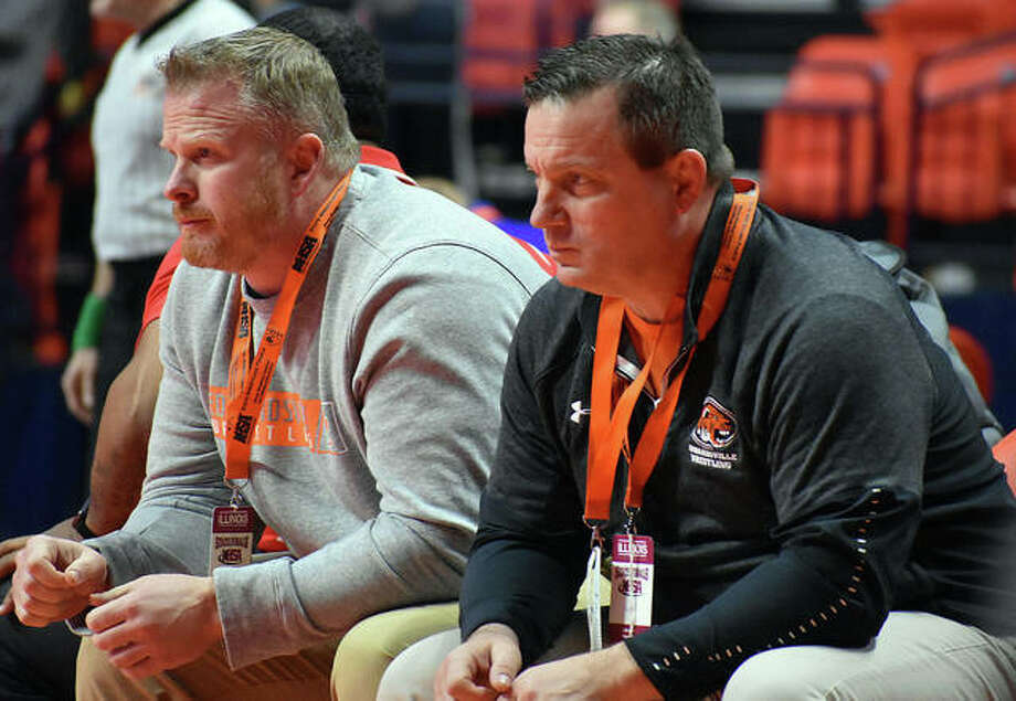 Edwardsville coach Jon Wagner, shown watching one of his wrestlers with assistant coach Doug Heinz at the Class 3A state meet in Champaign, is the 2020 Telegraph Wrestling Coach of the Year. Photo: Hearst Illinois File Photo