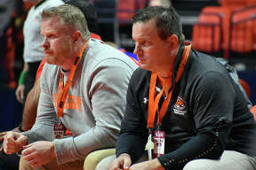 Edwardsville coach Jon Wagner, shown watching one of his wrestlers with assistant coach Doug Heinz at the Class 3A state meet in Champaign, is the 2020 Telegraph Wrestling Coach of the Year.
