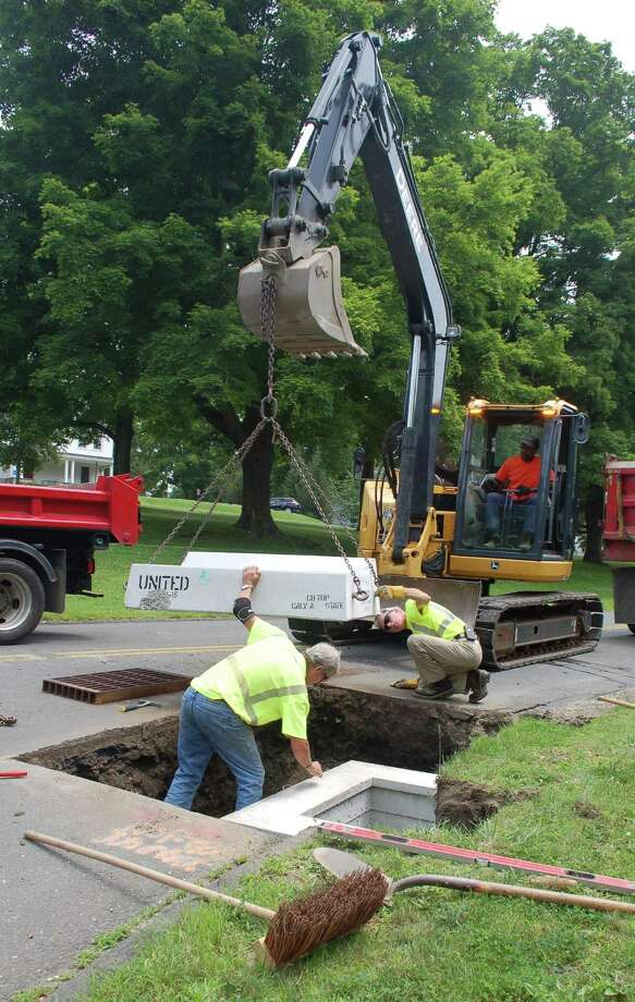 Over the years, recently retired Public Works Director Peter Hill emphasized the importance of drainage work on town roads. A crew is installing a catch basin on East Ridge Road in this 2015 photo. Photo: Macklin Reid / Hearst Connecticut Media File Photo