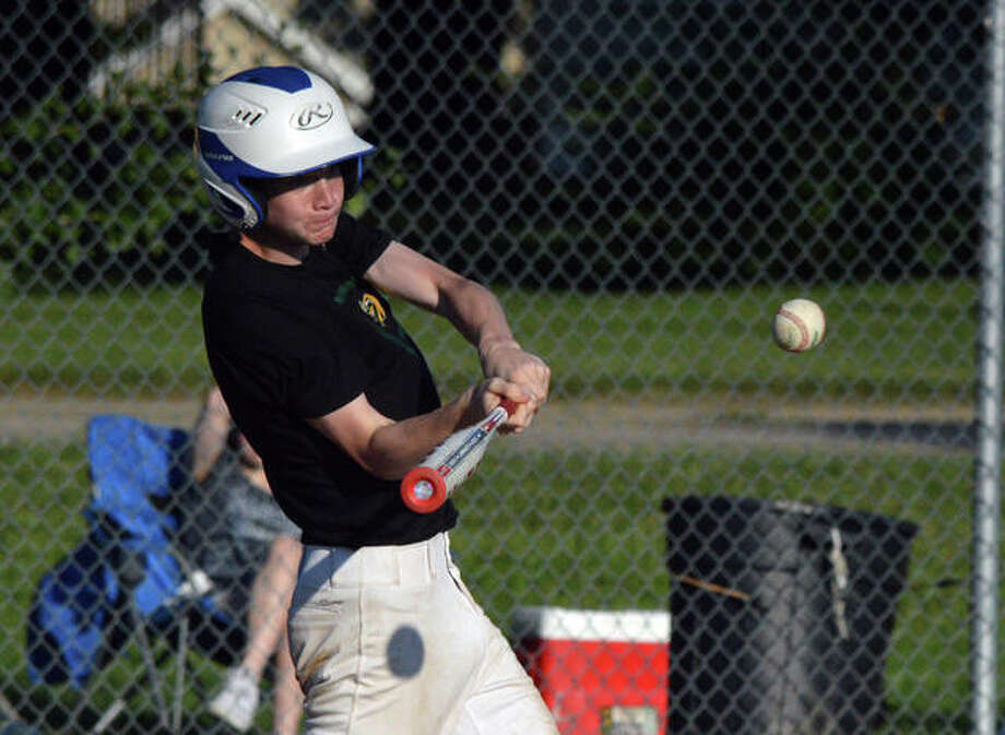 Metro-East Lutheran's Luke Neath drives a pitch for a single during a 10-0 summer league win over Valmeyer on July 24 at MELHS. Photo: Scott Marion/The Intelligencer