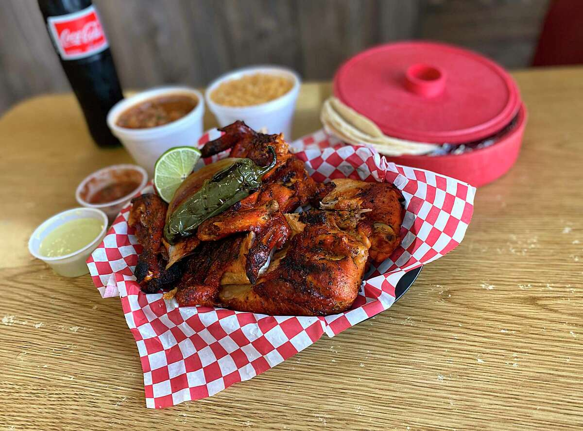 Even in a pandemic, San Antonians have a strong appetite for pollos asados - charcoal chicken slathered with achiote paste and spices and served family-style with rice, beans, tortillas, grilled onions and roasted jalapeños.
