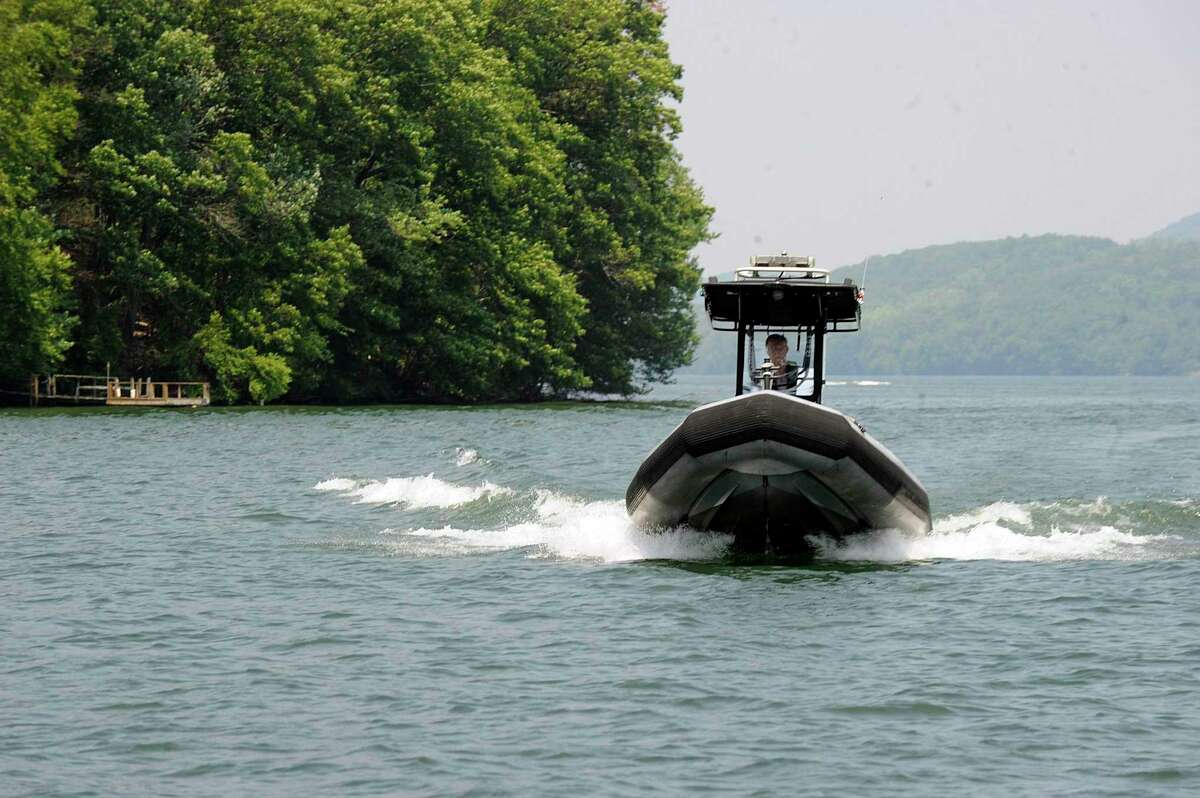 Steve Cammack, an officer with the DEEP Environmental Conservation Police, patrols Candlewood Lake Monday, July 2, 2018.