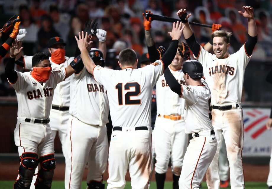 Mike Yastrzemski #5 of the San Francisco Giants celebrates with teammates after he hit a walk-off home run in the ninth inning against the San Diego Padres at Oracle Park on July 29, 2020 in San Francisco, California. (Photo by Ezra Shaw/Getty Images) Photo: Ezra Shaw/Getty Images / 2020 Getty Images