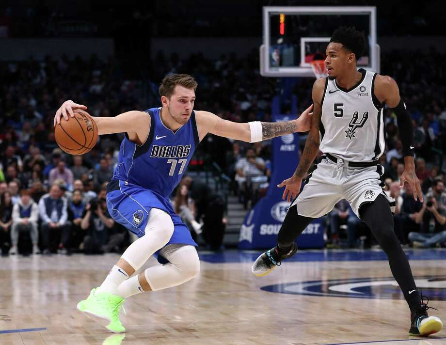Luka Doncic and the Mavericks face the Rockets at 8 p.m. Friday, and Dejounte Murray and the Spurs have a 7 p.m. game against the Kings. Photo: Ronald Martinez /Getty Images File / 2019 Getty Images