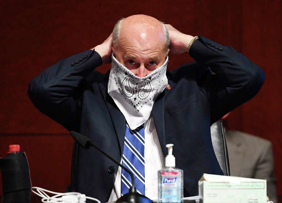 Rep. Louie Gohmert, R-Texas, adjusts his face mask during a House Judiciary Committee markup of the Justice in Policing Act of 2020 on Capitol Hill in Washington, Wednesday, June 17, 2020. Gohmert was diagnosed with COVID-19 on Wednesday. Photo: Kevin Dietsch, POOL / Associated Press / UPI