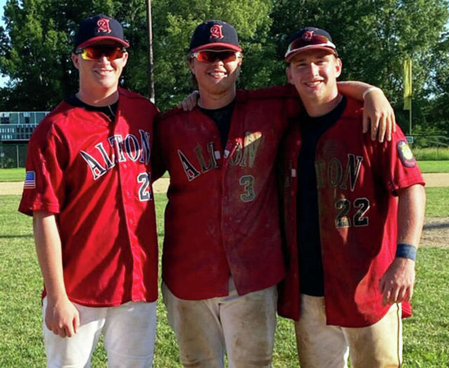 Alton Legion's most veteran players (from left) Gage Booten, Adam Stilts and Cullen McBride pose for a photo after their last game together on Sunday at Hopkins Field in Alton. Photo: Kelly Booten / For The Telegraph