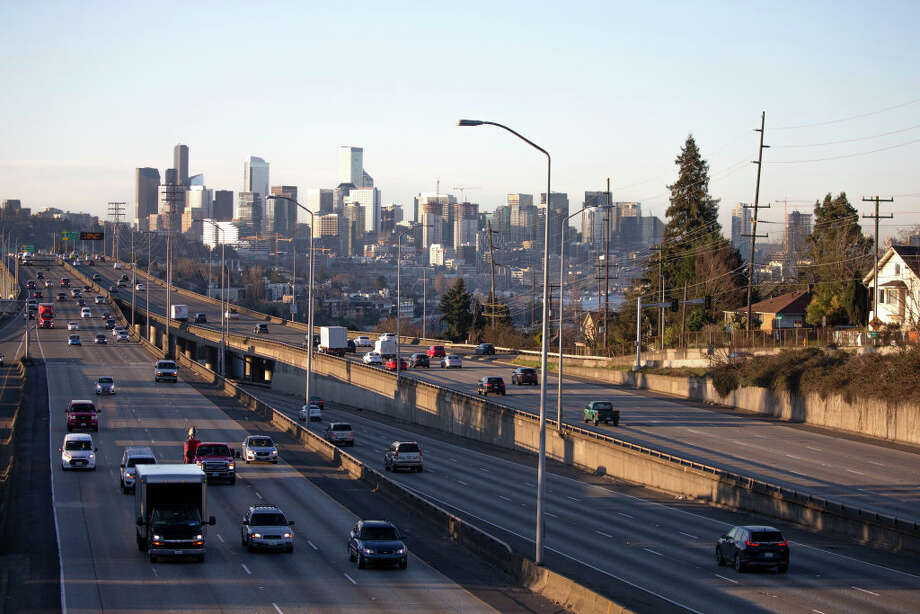 Washington State Patrol troopers arrested nine people participating in a protest in which vehicles blocked traffic on Interstate 5 through Seattle Friday, according to people at the scene and the State Patrol. Photo: Karen Ducey/Getty Images / 2020 Getty Images