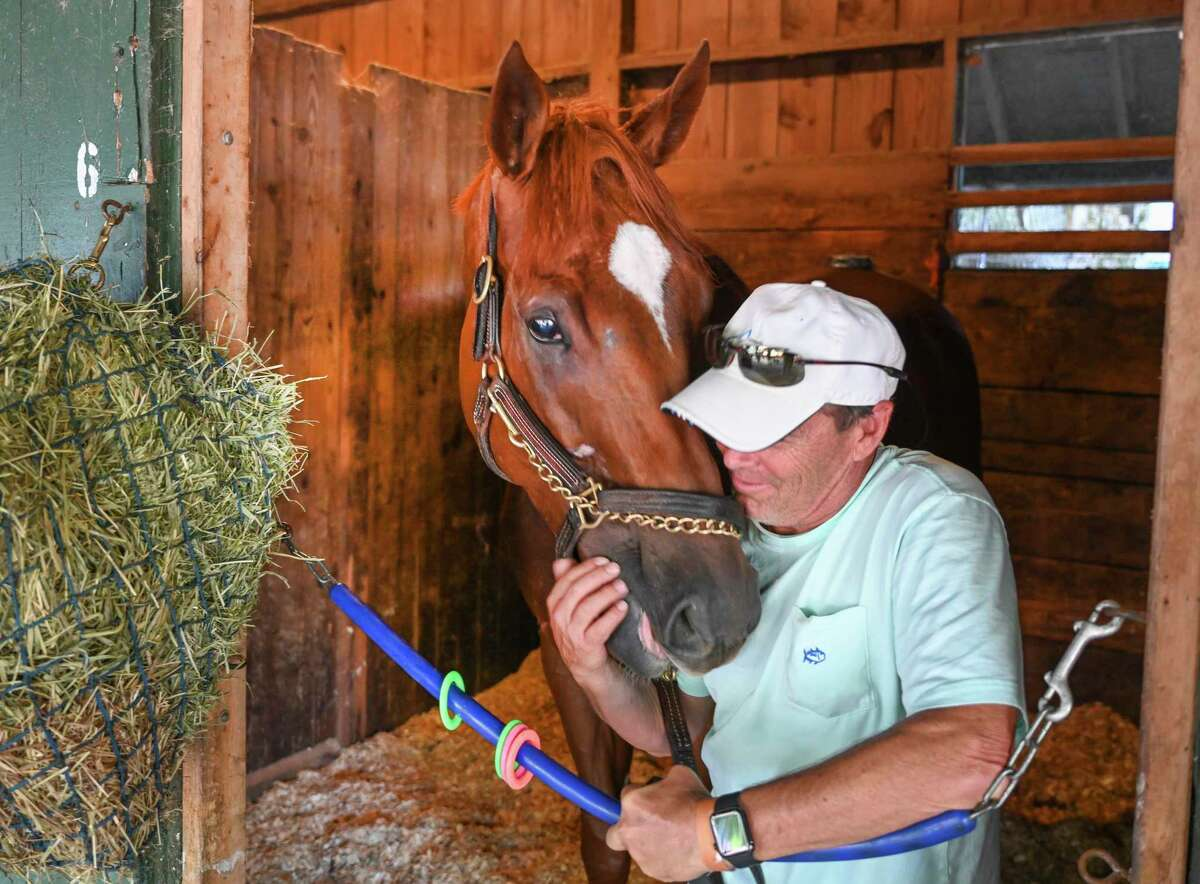 Trainer John Kimmel share a quiet moment with Whitney entrant Mr. Buff in the barn area at the Saratoga Race Course Thursday July 30, 2020 in Saratoga Springs, N.Y. Photo by Skip Dickstein/Special to the Times Union