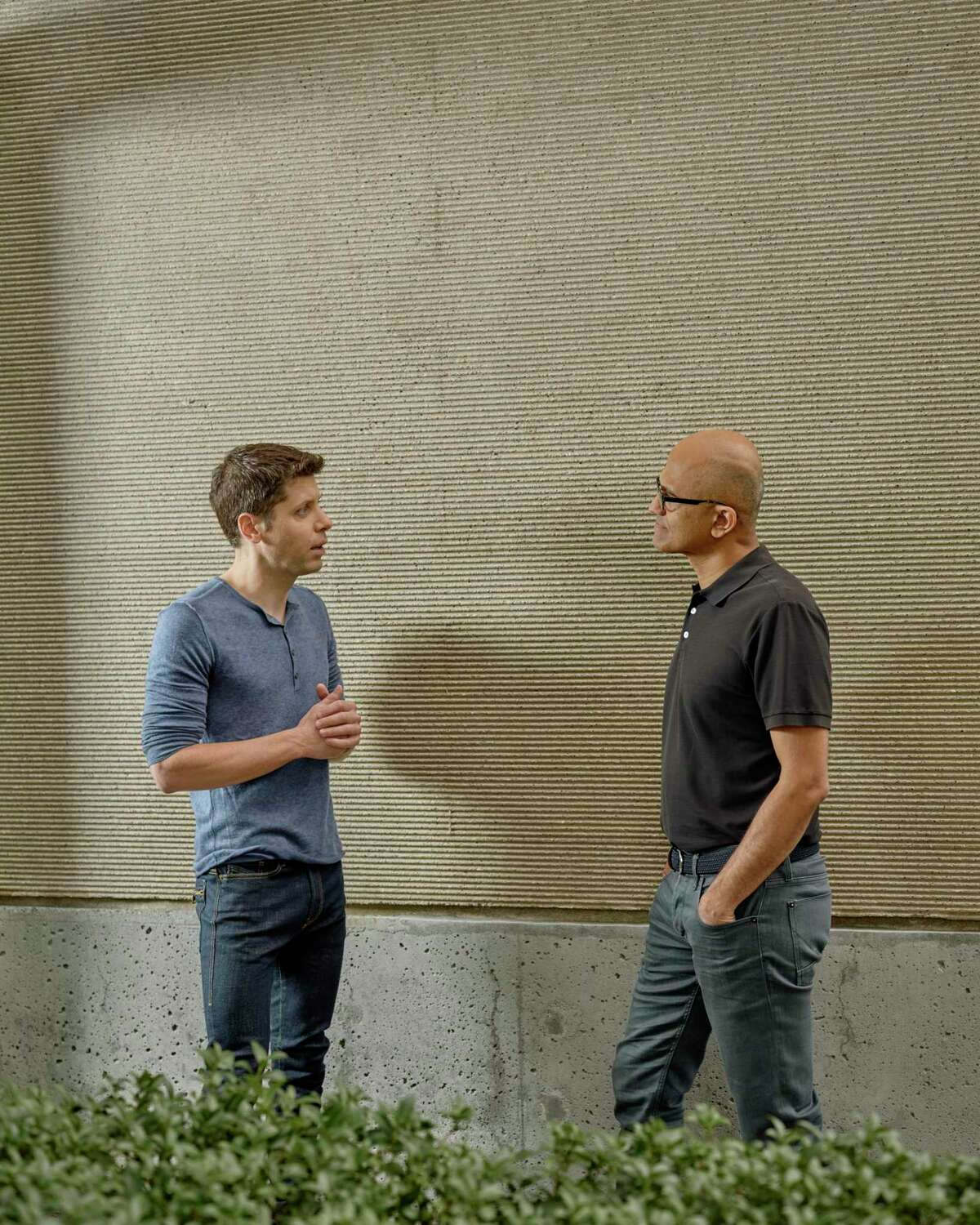 In 2019, Sam Altman (left) who manages the company OpenAI, talks with Satya Nadella, the chief executive of Microsoft, which is investing $1 billion in OpenAI, at the Microsoft Campus in Redmond, Wash. OpenAI's mission is to create a machine that can do what the human brain can do.
