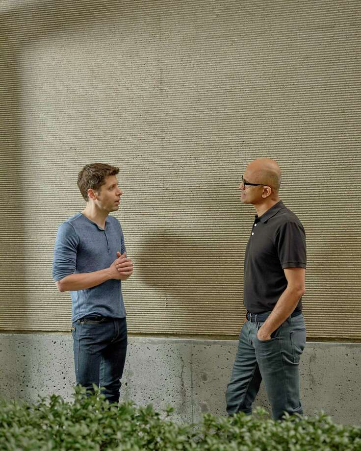 In 2019, Sam Altman (left) who manages the company OpenAI, talks with Satya Nadella, the chief executive of Microsoft, which is investing $1 billion in OpenAI, at the Microsoft Campus in Redmond, Wash. OpenAI's mission is to create a machine that can do what the human brain can do. Photo: Ian C. Bates /New York Times / NYTNS
