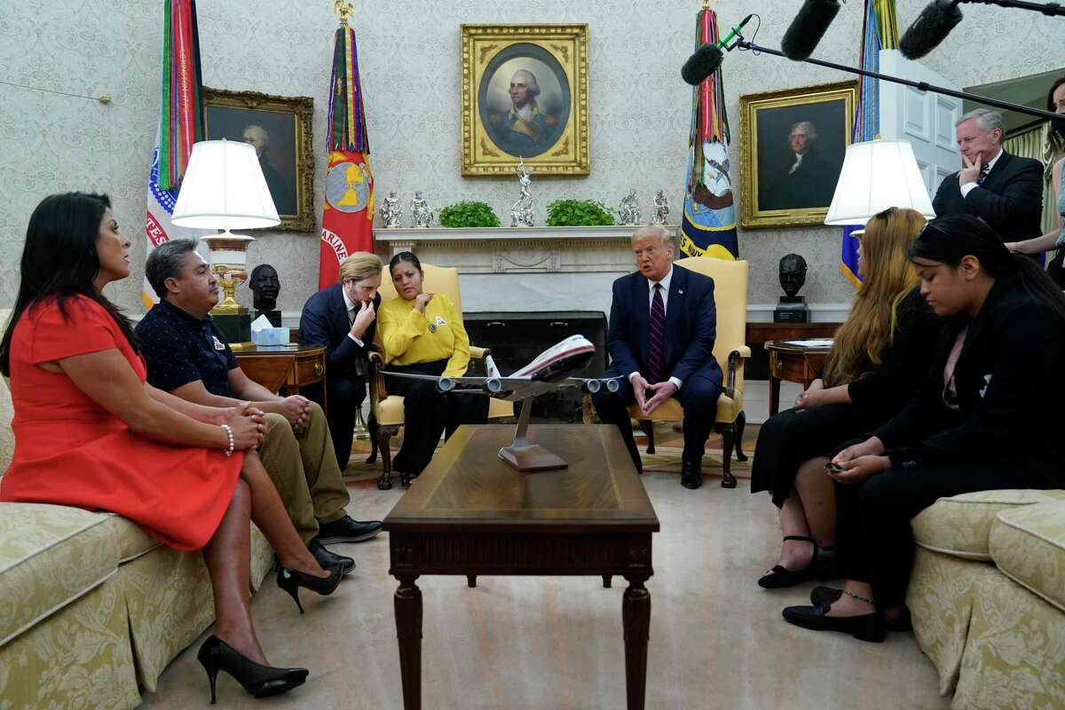 President Donald Trump speaks as he meets with the family of slain Army Spc. Vanessa Guillen in the Oval Office of the White House on Thursday, July 30, 2020, in Washington. Seated from left, family attorney Natalie Khawam, Vanessa's father Rogelio Guillen, Vanessa's mother Gloria Guillen, Trump, Vanessa's sister Mayra Guillen and Vanessa's sister Lupe Guillen. White House Chief of Staff Mark Meadows stands at top right.