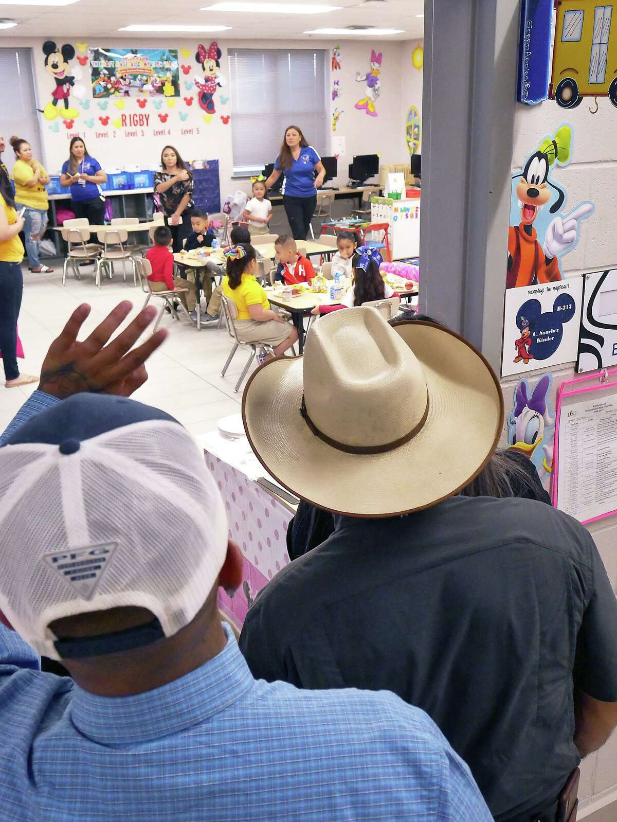 Family members wave and peek into the classroom after dropping off a student on the first day of the 2019-2020 school year at Zachry Elementary Monday, August 12, 2019.