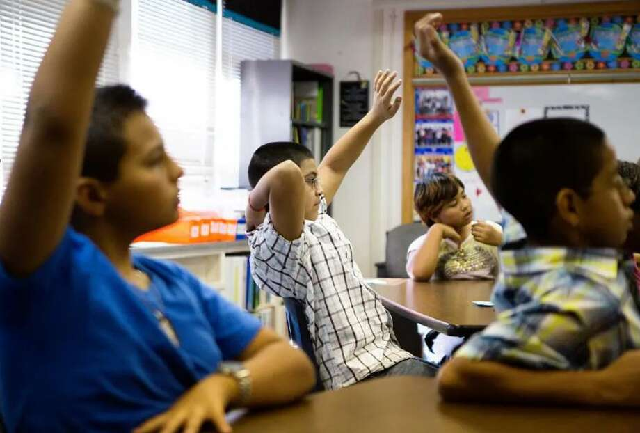 Students at Bayless Elementary in Lubbock raise their hands to answer a question. Photo: Jerod Foster /The Texas Tribune