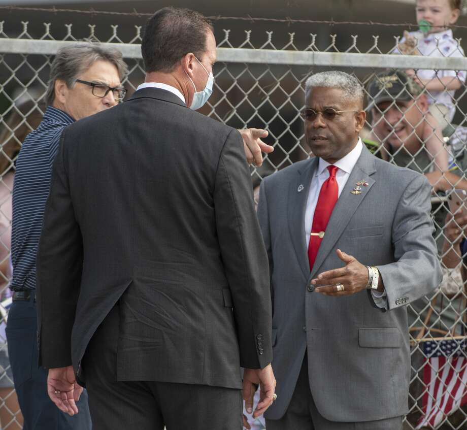 Allen West talks with Rick Perry and Senator-elect August Pfluger 07/29/2020 before the arrival of Air Force One. Tim Fischer/Reporter-Telegram Photo: Tim Fischer/Midland Reporter-Telegram