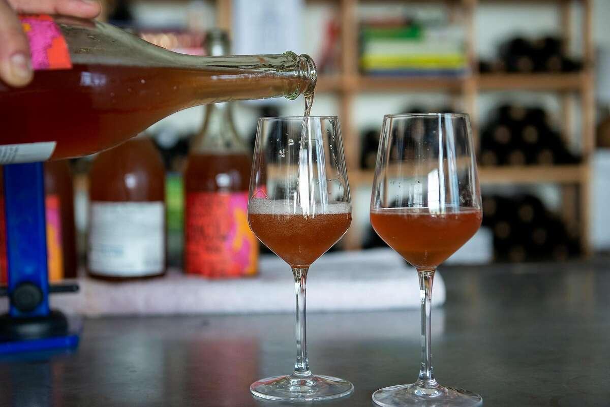 Noel Diaz, wine maker of Purity Wines, pouring wine bottles in his tasting room on July 24, 2020 in Richmond, Calif.