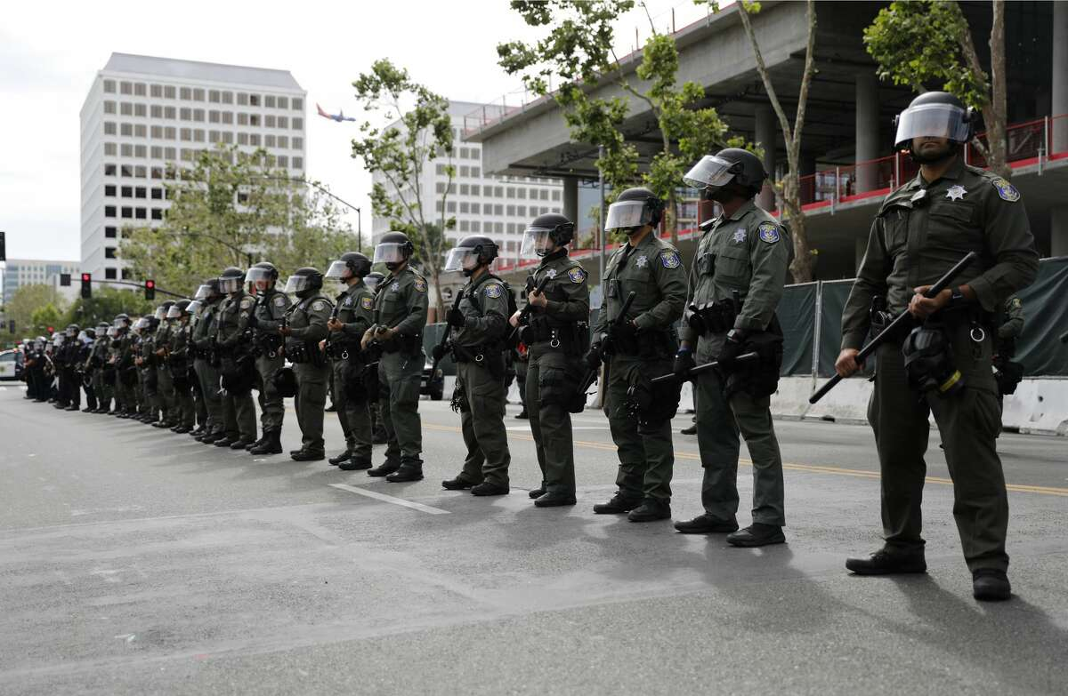 Santa Clara County Police officers line up next to San Jose Police officers during a protest of the killing of George Floyd outside of San Jose City Hall in downtown San Jose on Sunday, May 31, 2020.