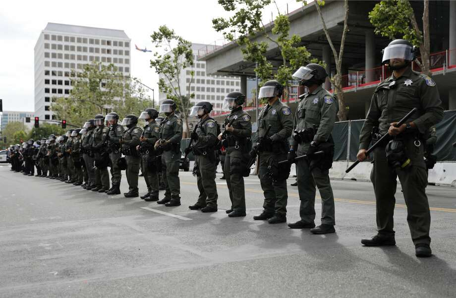 Santa Clara County Police officers line up next to San Jose Police officers during a protest of the killing of George Floyd outside of San Jose City Hall in downtown San Jose on Sunday, May 31, 2020. Photo: MediaNews Group/The Mercury News/MediaNews Group Via Getty Images / Bay Area News Group