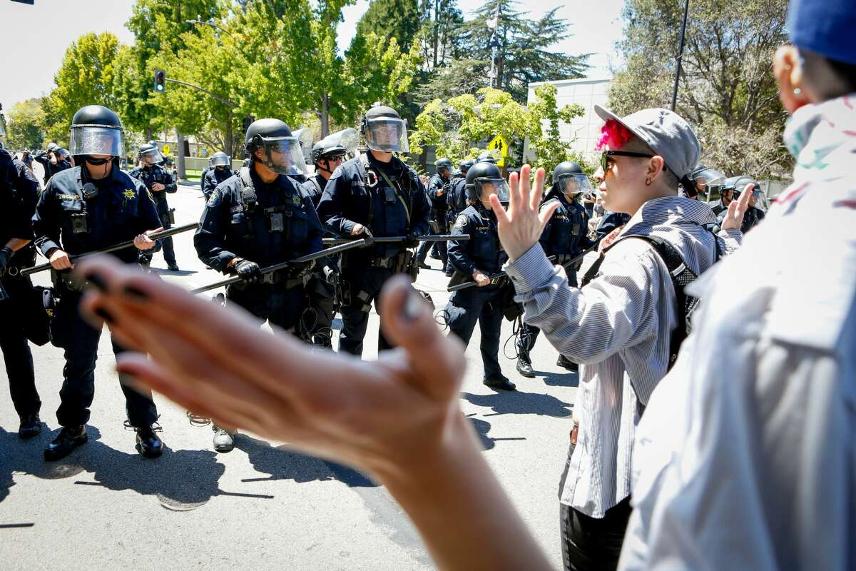 Police forces block counter protesters from entering Martin Luther King Civic Center park, where an alt-right rally takes place on August 5, 2018 in downtown Berkeley.