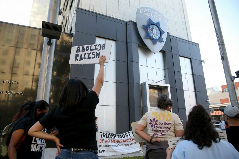 Protesters attend a rally after a short march to the Oakland police headquarters in downtown Oakland on Monday, June 29, 2020. The march was sponsored by BAMN, The Coalition to Defend Affirmative Action, Integration and Immigrant Rights and Fight For Equality by Any Means Necessary. Photo: MediaNews Group/East Bay Times V/MediaNews Group Via Getty Images / Bay Area News Group