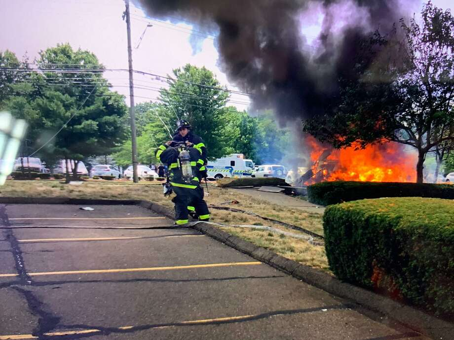 Norwalk, Conn., firefighters on scene for a four-vehicle crash where one vehicle burst into flames on Thursday, July 30, 2020. Photo: Contributed Photo / Norwalk Fire Department