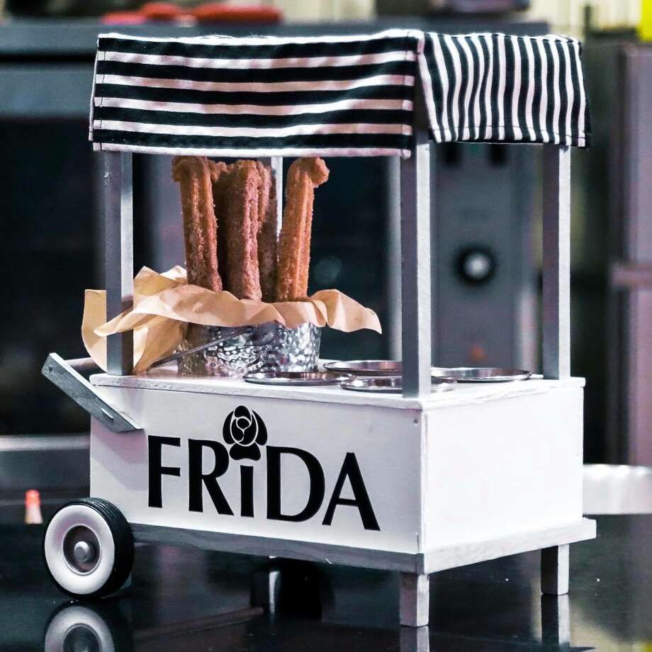 If guests at the new Frida Mexican Restaurant and Bar have room after filling up on Wagyu beef-topped Mexican hot dogs or rib eye tacos, they can round out their dinner with a personal churro cart. Photo: Courtesy, Frida Mexican Restaurant And Bar