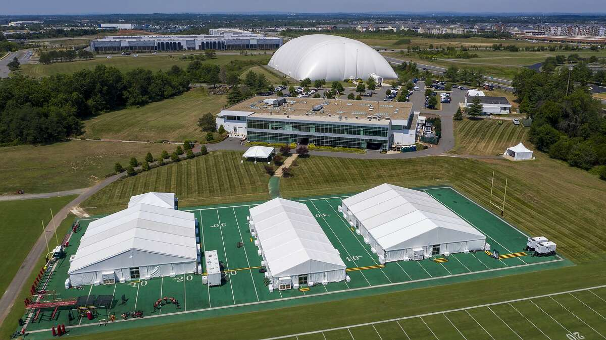 This aerial image shows the Washington NFL football teams training facility which includes large tents and a domed facility Thursday July 30, 2020, in Ashburn, Va. NFL football training camps will look different this year than it has in years past. Coronavirus health precautions has caused a lot of changes to NFL protocol ahead of the 2020 season. (AP Photo/Steve Helber)