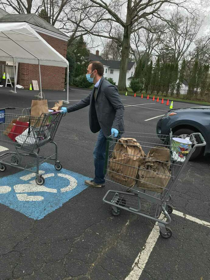 State Rep. Brian Farnen (R-132) unloads donations on the April 8 food drive. Photo: /Contributed