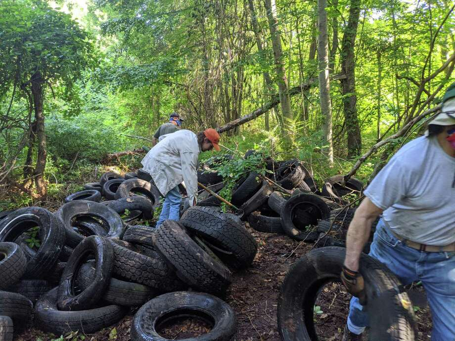 More than 20 volunteers removed 188 old tires from the wooded area beside Little Pond Trail. Photo: Contributed Photo / Connecticut Post