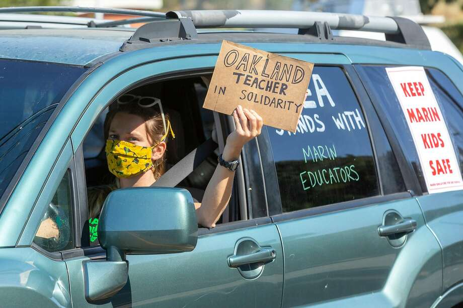 Shelby Ziesing joins a car-caravan protest outside Marin County Office of Education in San Rafael on July 16. Photo: Santiago Mejia / The Chronicle