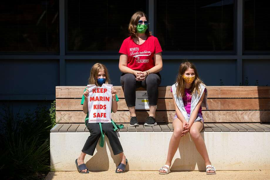 Mariah Fisher (top) with her children (from left) Abby, 10, and Ellie, 12, outside the Marin County Office of Education on Thursday, July 16. Photo: Santiago Mejia / The Chronicle