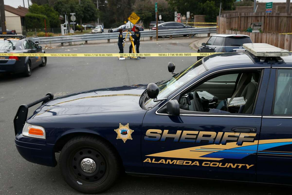 Alameda County Sheriffs crime scene technicians gather evidence after a car jacking suspect was shot and killed during a shootout with deputies near East 14th Street and the on-ramp to northbound I-238 in San Leandro, Calif. on Tuesday, Sept. 22, 2015.
