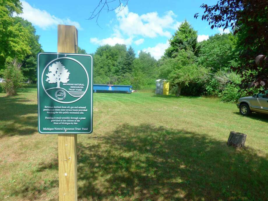 Local officials have begun a series of planned improvements at May Buell Park in Pleasanton Township, including the installation of new signage. (Scott Fraley/News Advocate)