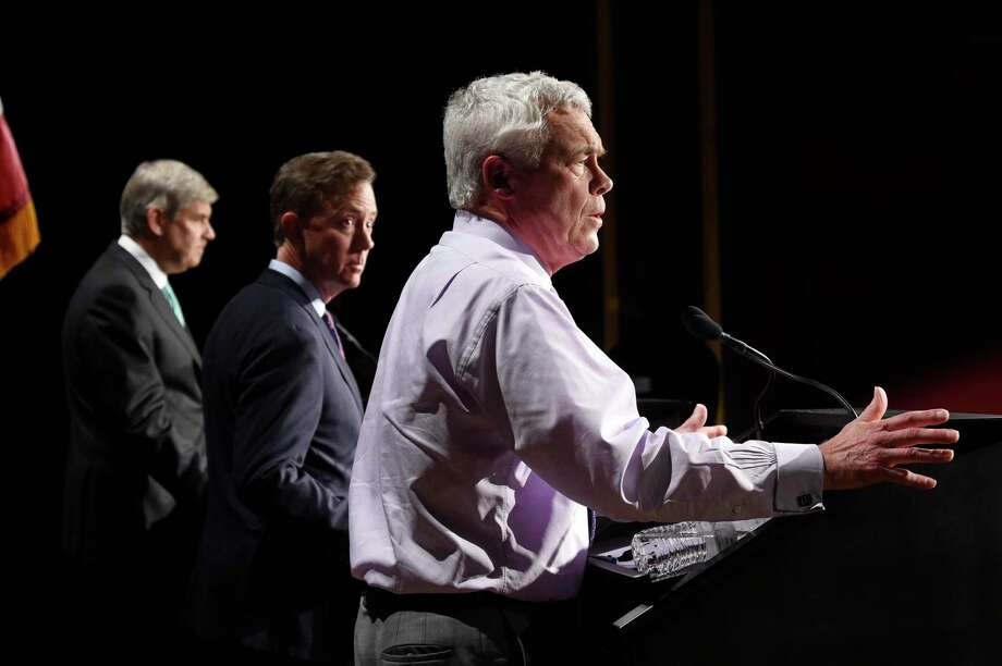 Independent gubernatorial candidate Oz Griebel, right, answers a question as opponents Ned Lamont, center, and Bob Stefanowski listen during the Connecticut Broadcasters Association gubernatorial debate, Thursday, Oct. 18, 2018 in Hartford, Conn. Griebel died July 29, 2020 at age 71 after being struck by a motor vehicle while jogging in Pennsylvania Photo: Cloe Poisson / Associated Press / Hartford Courant