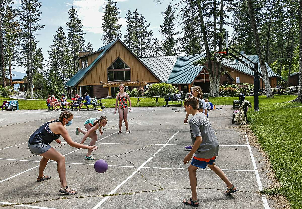 Children play on a court at a summer camp. (Hunter D'Antuono/Flathead Beacon via AP)