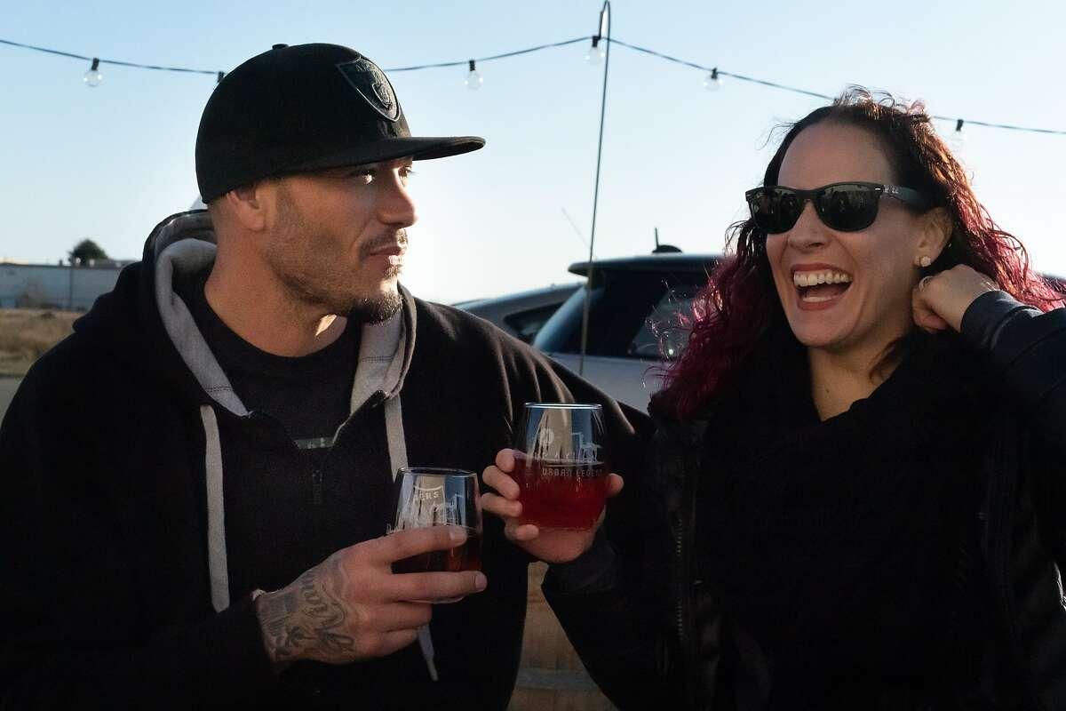 Gabriel Avila and Amelia Garcia enjoys wine at the Dashe Winery on Saturday, Nov. 23, 2019, in Alameda, Calif.