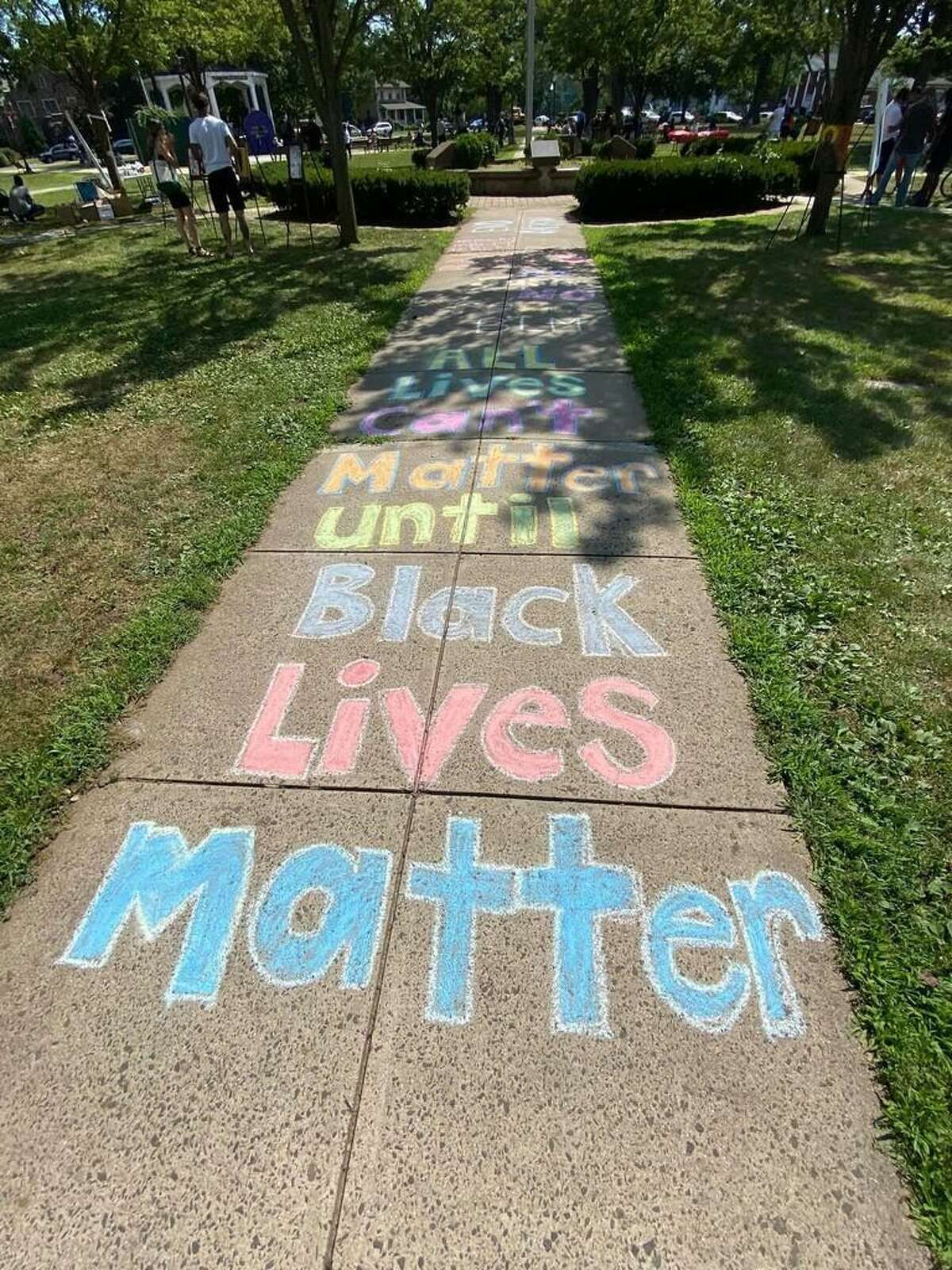 """Sidewalk chalk messages were part of a peaceful, expressive protest last weekend, organized by Brandon Patterson, a community and youth organizer who is leading the charge to have a semi-permanent """"Black Lives Matter"""" mural put in West Haven."""