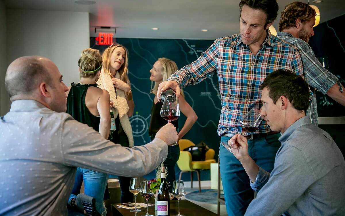 Winemaker/owner Matt Licklider pours wine for people at the Lioco Winery tasting room in Healdsburg, Calif. on September 6th, 2018.