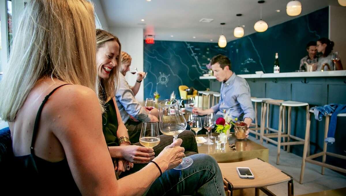 People taste wine at the Lioco Winery tasting room in Healdsburg, Calif. on September 6th, 2018.