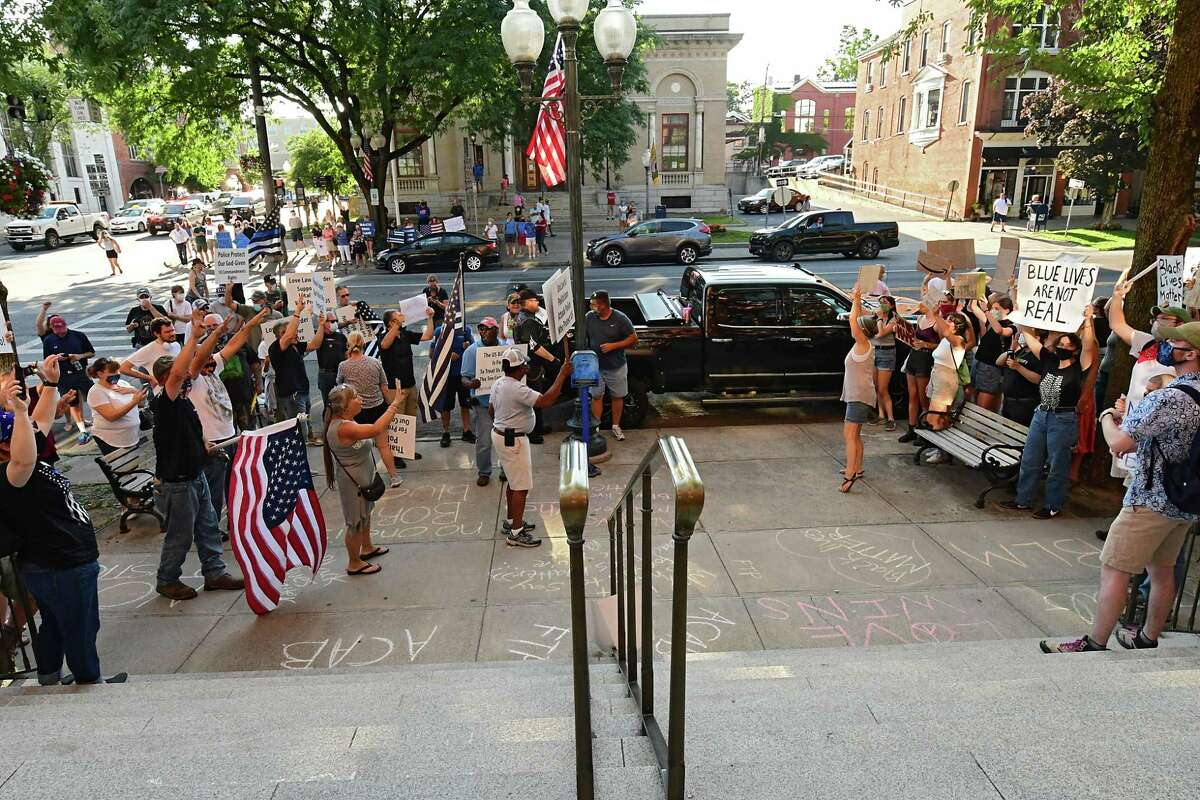 People rally in front of City Hall in support of the police, on the left, with counter protesters, on right on Thursday, July 30, 2020 in Saratoga Springs, N.Y. (Lori Van Buren/Times Union)