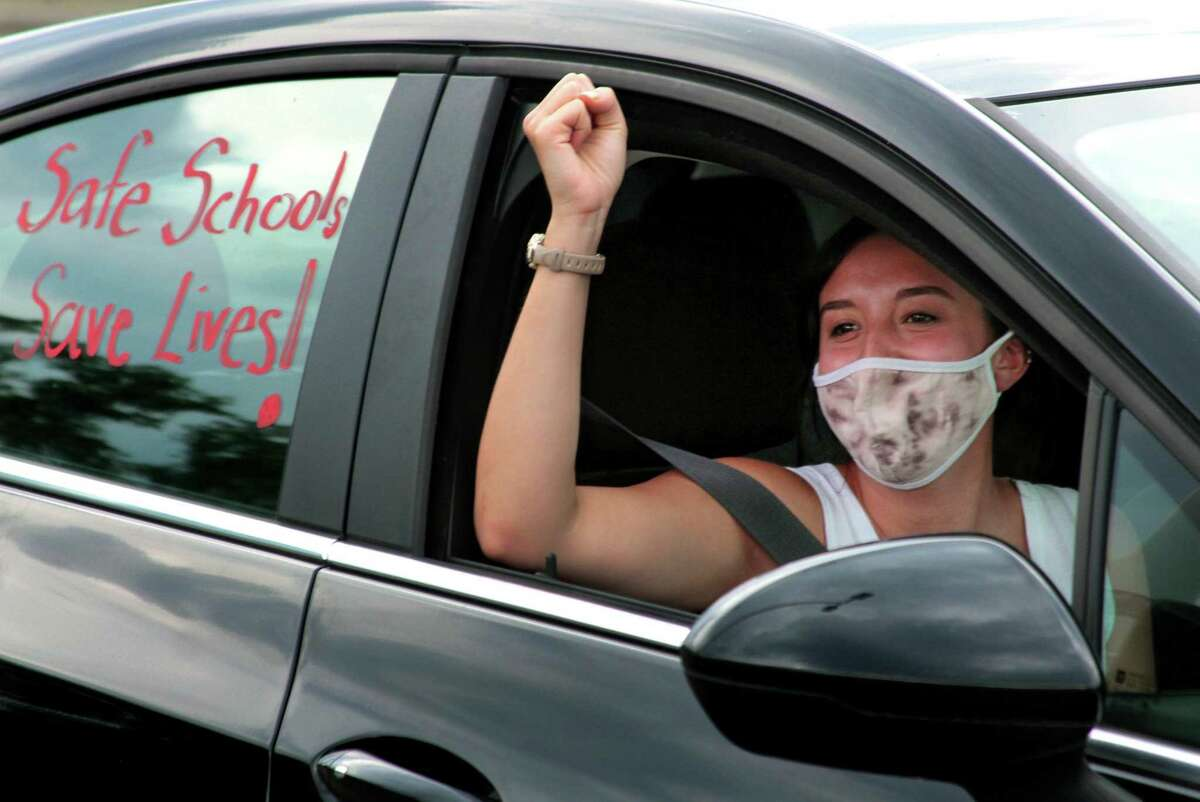 Lexi Marcus, a teacher at Jefferson Elementary School, lets out a cheer at the start of a